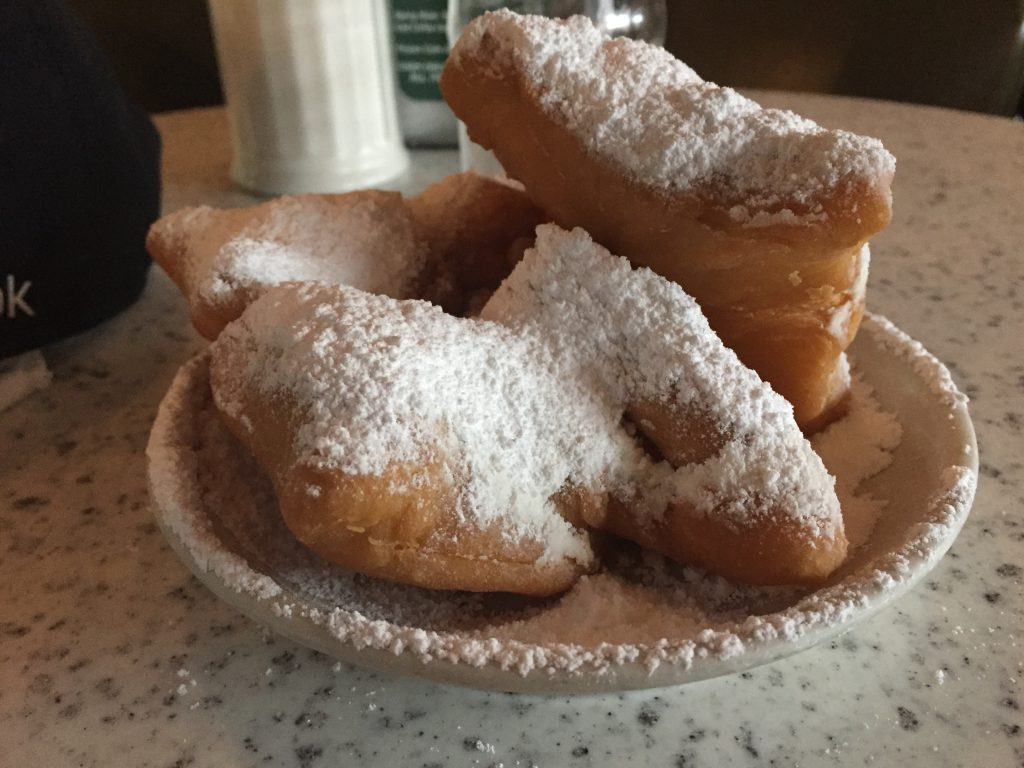 Beignets from Cafe du Monde New Orleans sports teams travel guide