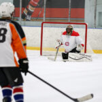 Beer league ice hockey goaltender