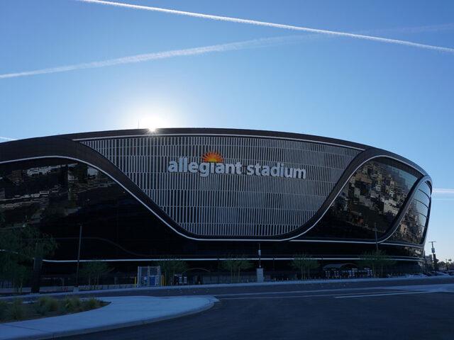 Allegiant Stadium in Las Vegas with the sun rising over the stadium
